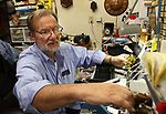 TORRINGTON CT. 19 April 2017-041917SV01-Al Michalowski works on a clock at his shop Country Clocks in Torrington Wednesday.<br /> Steven Valenti Republican-American