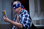 A protester does a performance while protesters of the Occupy Wall Street movement celebrate their first anniversary with marches and confrontations with the New York police where 150 protesters have been arrested during weekend celebrations in Manhattan.  Photo by Eduardo Munoz Alvarez / VIEWpress.