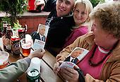 LOMZA, POLAND, JUNE 15, 2010:.Jaroslaw Kaczynski on the campaign trail:.Supporters Przemek, Agnieszka, Krystyna with J.Kaczynski leaflet during rally on the main square Lomza, north east Poland. .(Photo by Piotr Malecki / Napo Images)..LOMZA, 15/06/2010:.Przemek, Agnieszka, Krystyna i ulotki J. Kaczynskiego podczas spotkania wyborczego..Jaroslaw Kaczynski. Spotkanie z wyborcami..Fot: Piotr Malecki / Napo Images.