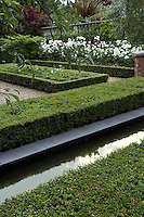 Striking abstract and geometric patterns are created by the simple design of the box hedging