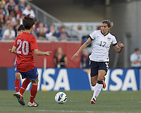USWNT midfielder Tobin Heath (17) brings the ball forward.  In an international friendly, the U.S. Women's National Team (USWNT) (white/blue) defeated Korea Republic (South Korea) (red/blue), 4-1, at Gillette Stadium on June 15, 2013.