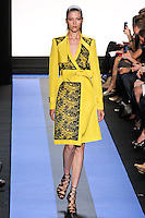 Yulia walks runway in a cadmium yellow faille trench coat with backed lace detail, by Monique Lhuillier, from the Monique Lhuillier Spring 2012 collection fashion show, during Mercedes-Benz Fashion Week Spring 2012.