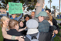"Activist Jerry Rubin (center) with other environmentalists hugs the, ""Children's Tree of Life""  at Palisades Park during  Alliance for Survival Peace and Environmental Group's 'Tree-Hugging Day' on Friday, March 18, 2011. ""You're not embarrassed to smell a rose, so why be embarrassed to hug a tree?"" said Rubin."