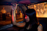 Kimmy one of the 'Me N Ma Girls', Myanmar's first girl band, in the back of a taxi going to her evening job as a bar singer. The band's members were recruited by Australian dancer Nicole May. They sing and dance in the manner of many Western pop acts but in socially conservative Myanmar, they represent a radical break from the norm.