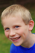Portrait of young boy with autism smiling.  MR