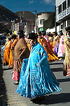 Dancing Cholitas, dressed in the traditional indigenous Aymaran clothing of bowler hats, mantas or shawls and pollera dresses, celebrate a religious festival through the streets of La Paz, Bolivia.