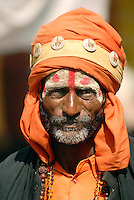 Sadhus in India have left behind all material attachments for a life of spiritual devotion. They are often wear ochre-colored clothing, which symbolizes renunciation. Posing as a Sadhu during festivals can be an easy way to make a quick couple of Rupees from unsuspecting tourists.