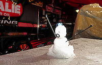 Feb. 26, 2011; Pomona, CA, USA; A snowman sits in the pits of NHRA top fuel dragster driver Terry McMillen after hail fell in the pro pits qualifying at the Winternationals at Auto Club Raceway at Pomona. Mandatory Credit: Mark J. Rebilas-.