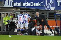 VOETBAL: HEERENVEEN: Abe Lenstra Stadion, 09-12-2012, Eredivisie 2012-2013, SC Heerenveen - Roda JC, Eindstand 4-4, Sven Kums (SCH), Marten de Roon (SCH), Rajiv van La Parra ligt samen met Marco van Basten (trainer/coach) op de grond na de 2-1, Henk Herder (assistent-trainer), ©foto Martin de Jong