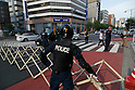 August 15, 2011, Tokyo, Japan - Police man a barricade on Yasukuni dori as a left-wing demonstration approaches Yasukuni shrine. (Photo by Bruce Meyer-Kenny/AFLO) [3692]