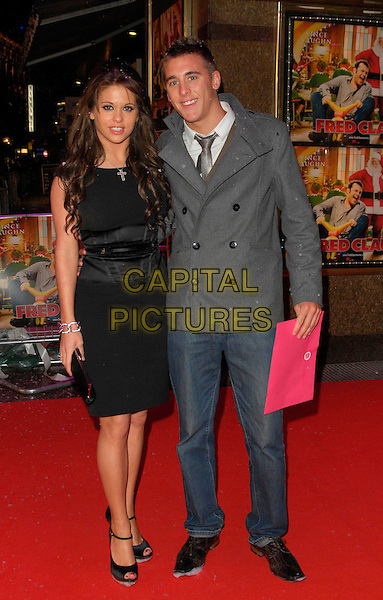 """BIANCA GASCOIGNE & GUEST.Attending the European Film Premiere of """"Fred Claus"""" at the Empire Leicester Square, London, England,.November 19th 2007..full length  black dress.CAP/CAN.©Can Nguyen/Capital Pictures"""