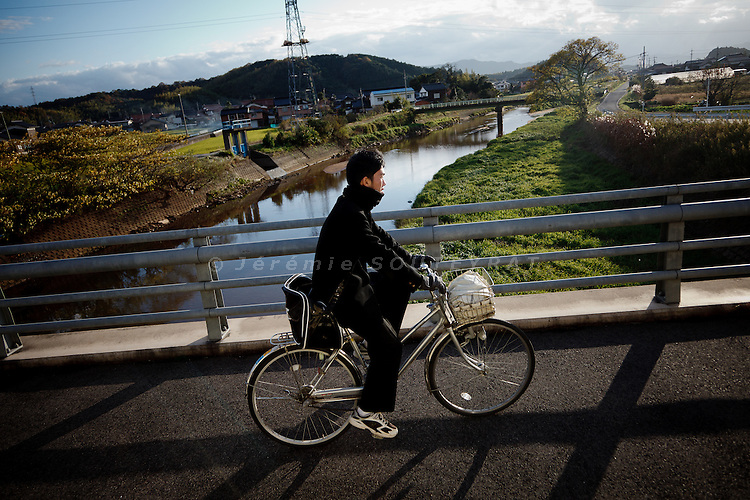 Tottori prefecture,  November 25 2011 - A high school student coming back home by bicycle.