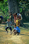 Asia, Nepal, Bardia. Boys playing marbles, a game enjoyed by Tharu children in Bardia.