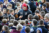 Picture by Alex Whitehead/SWpix.com - 12/11/2013 - Rugby League - Rugby League World Cup - New Zealand Training - John Charles Centre for Sport, Leeds, England - New Zealand's Sonny Bill Williams signs autographs and poses for photos with the hundreds of local school children in attendance.
