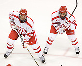 Sean Escobedo (BU - 21), Ross Gaudet (BU - 22) - The visiting Boston College Eagles defeated the Boston University Terriers 3-2 to sweep their Hockey East series on Friday, January 21, 2011, at Agganis Arena in Boston, Massachusetts.