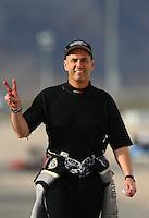 Apr 10, 2015; Las Vegas, NV, USA; NHRA top fuel driver Larry Dixon reacts during qualifying for the Summitracing.com Nationals at The Strip at Las Vegas Motor Speedway. Mandatory Credit: Mark J. Rebilas-