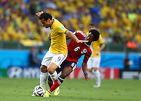 Fred of Brazil is fouled by Carlos Sanchez of Colombia