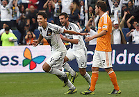 CARSON, CA - DECEMBER 01, 2012:   Omar Gonzalez (4) and  Tommy Meyer (21) of the Los Angeles Galaxy pass Bobby Boswell (32) of the Houston Dynamo after Gonzalez had scored the first Galaxy goal during the 2012 MLS Cup at the Home Depot Center, in Carson, California on December 01, 2012. The Galaxy won 3-1.