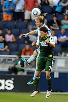 Seth Sinovic (16) defender Sporting KC out jumps Sal Zizzo (7) midfielder Portland Timbers...  Sporting Kansas City defeated Portland Timbers 3-1 at LIVESTRONG Sporting Park, Kansas City, Kansas.