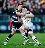 Elliott Stooke of London Irish is tackled by Francois Louw of Bath Rugby. Aviva Premiership match, between Bath Rugby and London Irish on March 5, 2016 at the Recreation Ground in Bath, England. Photo by: Patrick Khachfe / Onside Images