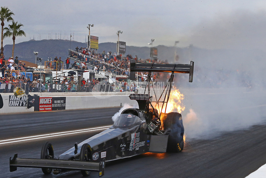 Feb 26, 2017; Chandler, AZ, USA; NHRA top fuel driver Shawn Reed has an engine fire during the Arizona Nationals at Wild Horse Pass Motorsports Park. Mandatory Credit: Mark J. Rebilas-USA TODAY Sports