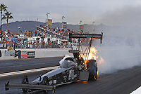 Feb 26, 2017; Chandler, AZ, USA; NHRA top fuel driver Shawn Reed has an engine fire during the Arizona Nationals at Wild Horse Pass Motorsports Park. Mandatory Credit: Mark J. Rebilas-USA TODAY Sports