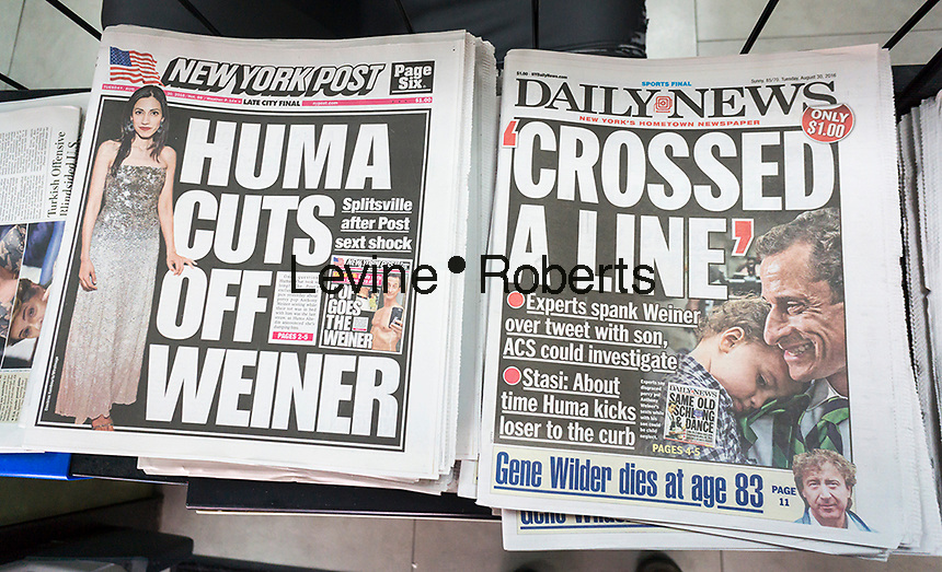 Headlines of the New York tbloid newspapers on Tuesday, August 30, 2016 report on Hillary Clinton aide, Huma Abedin, separating from her husband, the disgraced Anthony Weiner, after yet another sexting episode. (© Richard B. Levine)