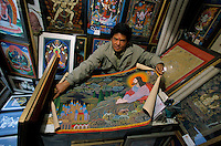 A sealer with a unusual but original Orthodox Christ Thangka, in one of many shop in Durbari Square in Kathmandu. The lamas who paint thangkas use painting as a form of spiritual education and can spend up to 9 months on each canvas. Thangkas are seen hanging in every temple, monastery and family shrine in Tibet and Nepal.
