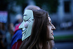 A girl with a Guy Fawkes mask looks on as she takes part in a casserole march to protest against government's austerity reforms and the public payment of bank's debts on October 13, 2012 in Madrid. © Pedro ARMESTRE