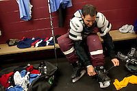 Republican presidential hopeful Tim Pawlenty laces up his skates before playing in a scrimmage hockey game during a campaign stop on Friday, July 22, 2011 in Urbandale, IA.