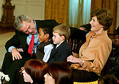"""Washington, D.C. - December 4, 2006 -- United States President George W. Bush and first lady Laura Bush participate in Children's Holiday Reception and Performance of """"Willy Wonka and the Chocolate Factory"""" in the East Room of The White House in Washington, D.C. on Monday, December 4, 2006. .Credit: Ron Sachs / CNP"""