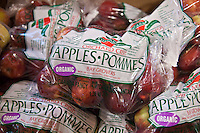 Bags of organic apples.