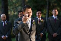 Groom tears up when seeing bride as she walks down aisle.