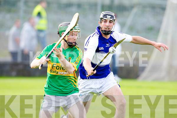 Lixnaw's James Flaherty goes for the point as St Brendan's Stephen Leen tries to block in the quarter final of the hurling senior championship at Austin Stack park, Tralee on Tuesday.