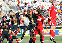 Amobi Okugo #14 of the Philadelphia Union goes for the ball against Adrian Cann #12 of Toronto FC during an MLS match at PPL stadium in Chester, PA. on July 17 2010. Union won 2-1 with a last minute penalty kick goal.