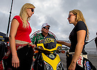 Aug 31, 2014; Clermont, IN, USA; NHRA  funny car driver John Force (center) with daughter Courtney Force (left) and Brittany Force during qualifying for the US Nationals at Lucas Oil Raceway. Mandatory Credit: Mark J. Rebilas-USA TODAY Sports