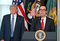 United States Secretary of the Treasury Steven Mnuchin makes remarks as US President Donald J. Trump looks on prior to the President signing three Executive Orders concerning financial services at the Department of the Treasury in Washington, DC on April 21, 2017.<br /> Credit: Ron Sachs / Pool via CNP /MediaPunch