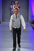 Fashion designer Luis Machicao, walks the runway at the close of his Luis Machicao Couture Spring Summer 2012 fashion show, during Couture Fashion Week, Spring 2012.