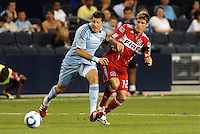 Luke Sassano (blue) Sporting KC, Logan Pause Chicago Fire...Sporting KC were held to a scoreless tie with Chicago Fire in the inauguarl game at LIVESTRONG Sporting Park, Kansas City, Kansas.
