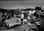 Housecleaning in a shanty town by destitute migrant couple on the outskirts of Chaoyang, Guangdong, China.