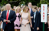 US President Donald Trump , Tiffany Trump, First Lady Melania Trump , Eric Trump and Barron Trump attend the annual Easter Egg Roll on the South Lawn of the White House  in Washington, DC, on April 17, 2017. <br /> CAP/MPI/CNP/RS<br /> &copy;RS/CNP/MPI/Capital Pictures