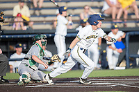 Michigan Wolverines designated hitter Nick Poirier (28) follows through on his swing during the NCAA baseball game against the Eastern Michigan Eagles on May 16, 2017 at Ray Fisher Stadium in Ann Arbor, Michigan. Michigan defeated Eastern Michigan 12-4. (Andrew Woolley/Four Seam Images)