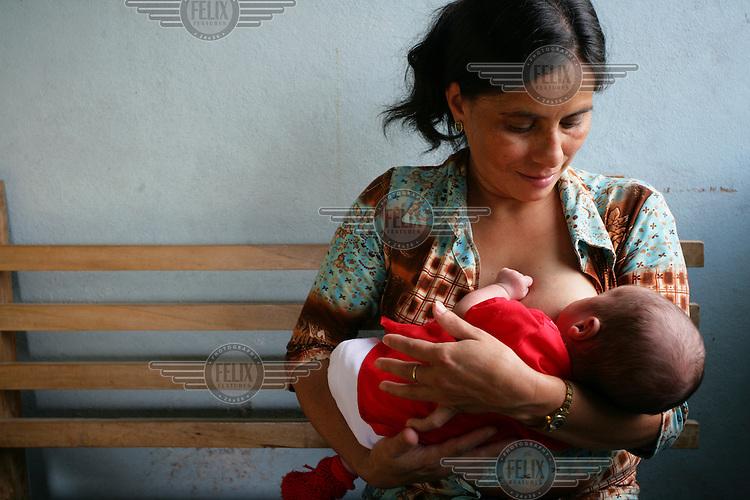 A mother breastfeeding her baby at El Porvenir Health Unit.