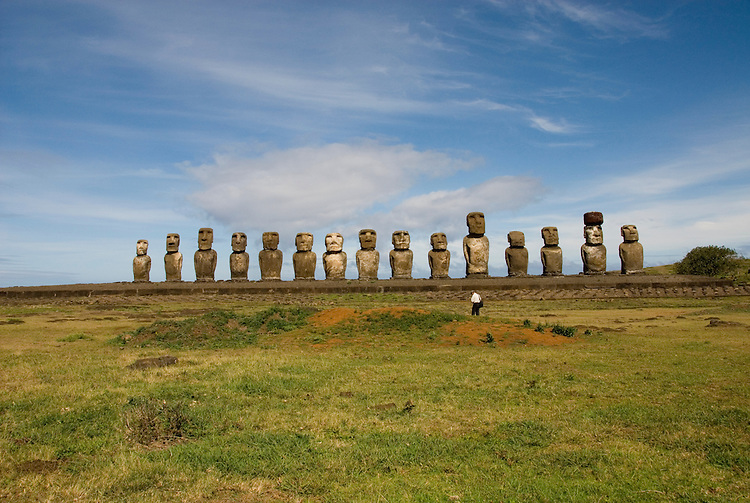 Chile, Easter Island: Array of statues or moai on a platform or ahu at Ahu Tongariki, near the quarry Rano Raruku.  This is the largest array of moia on Easter Island, consisting of 15 moai..Photo #: ch246-32727..Photo copyright Lee Foster www.fostertravel.com lee@fostertravel.com 510-549-2202