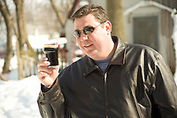 Dan Gohr checks out his home brewed beer.