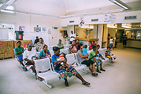 Patients in the waiting room of the renovated Leiroj Kitlang Memorial Health Centre.