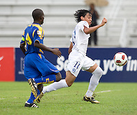 David Carranza (11) of Honduras tries to sprint past Amal Mayers (9) of Barbados during the group stage of the CONCACAF Men's Under 17 Championship at Catherine Hall Stadium in Montego Bay, Jamaica. Honduras defeated Barbados, 2-1.