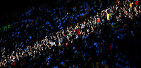 Fans are seen in gap of sunlight during the USA and Slovenia game
