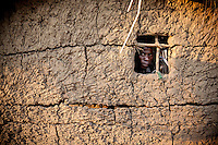 Malawian witchdoctor Sukweya Chikwawa (34) looks out from his window. Sukweya is not a member of the Mozambican traditional healer's association AMETRAMO and works in in the country illegally.
