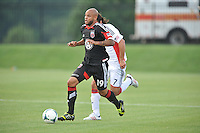 Kyel Porter (19) of D.C. United goes against Juan Toja (7) of the New England Revolution. D.C. United defeated the The New England Revolution 3-1 in the Quarterfinals of Lamar Hunt U.S. Open Cup, at the Maryland SoccerPlex, Tuesday June 26 , 2013.